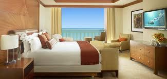TheCoveAtlantis AzureSuites Bedroom; TheCoveAtlantis AzureSuites LivingArea