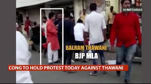 Shocking Video Of Bjp Mla Balram Thawani Kicking Woman Goes Viral