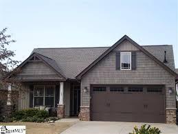 brown garage doorssince we already have dark brown accents  trim that i plan on