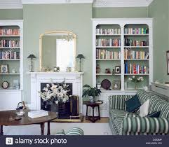 For Bookcases In Living Rooms Fitted White Bookcases On Either Side Of Fireplace In Gray Green