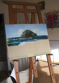 my school easel with the half finished painting of liuards relaxing at trebarwith strand
