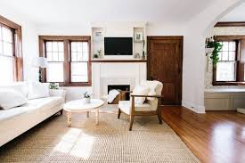 I love the woodwork with the soft white walls and the dark wood floors.  What color are the walls?
