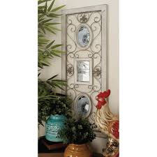 wooden white wall panel with photo frames