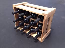 thinkeco² is making good use of aged weathered and rustic fences by handcrafting 100 recycled cedar gifts including wine racks wine and liquor gift