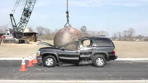 Image result for crane with wrecking ball smashing a person images