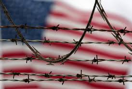 u s sends afghans home from guantanamo a sign of confidence in an american flag flies behind the barbed and razor wire at the camp delta detention