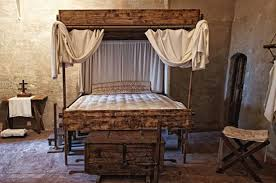 Medieval Bedroom Decked Up With Bed Stool Chest And Table