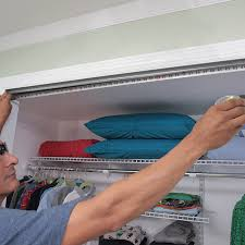 man measuring the closet opening