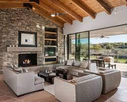 Trendy living room photo in Phoenix with a standard fireplace, a stone  fireplace and a