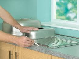 how to install a kitchen sink endearing fitting kitchen sink