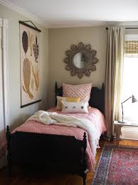 remarkable small guest room with unique wall mirror