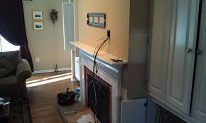 wallingford ct lg tv over fireplace with wires