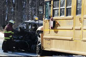 Pickup truck hits school bus, catches fire; baby, driver saved ...