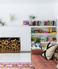 other successful examples of a painted stone fireplace are below