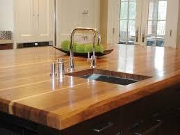 kitchen wooden kitchen worktops beige fabric windows blinds teak wood cabinet stainless steel swivel bar