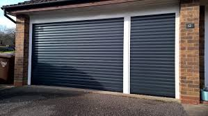 pair of novoroll 77 automated insulated roller garage doors fully finished in painted anthracite grey installed in banbury oxfordshire