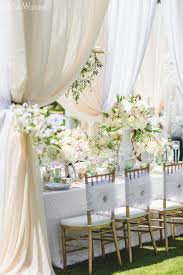 elegant decorations wedding table lights. White Feathery Draped Wedding Table Setting, Feather Chair Covers, And Pink Centerpieces/centrepieces, Place Poolside Wedding, Light Elegant Decorations Lights