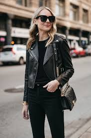blonde woman wearing club monaco black leather jacket black sweater chanel boy bag fashion jackson dallas