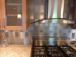 minimalist kitchen ideas with gray subway glass self stick tile backsplash stainless steel stove hood appliance and maple wood frosted glass cabinet doors