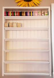 craft storage rack made with beadboard and moulding for diy ribbon storage and organization