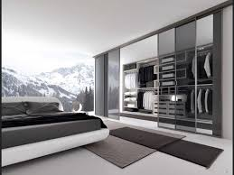 ont mens bedroom with high glass windows also glass walk in closet with sliding doors
