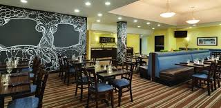restaurant with booths tables chairs and chalkboard inspired wall designs