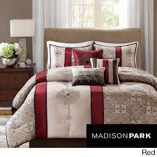 this comforter set includes seven items and features a modern colorblock look with embroidered taupe pattern