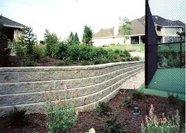 gray block wall curved retaining wall retaining and landscape wall woody s custom landscaping inc battle