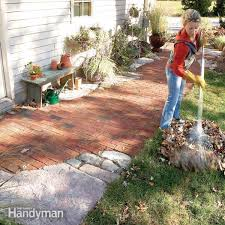 create an heirloom garden pathway or sidewalk by combining bricks or pavers with natural stone accent pieces learn the simple time tested techniques used