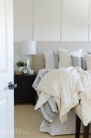 this cozy farmhouse master bedroom features a beautiful diy shiplap fireplace indigo ticking strip bedding