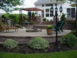 landscape patios. Raised Patio With Waterfall Landscape Patios