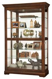 howard miller sliding door mirrored cherry curio cabinet cherry finish plate groove shelves