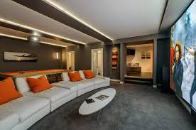 modern home theater. modern home theater with grey walls and white seats e