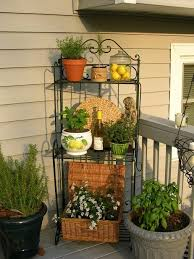 what to do with that old baker s rack make a plant stand and set it
