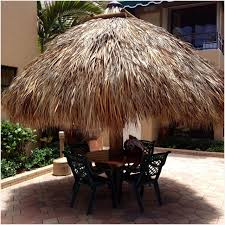 palm tree patio umbrella inviting a real tiki hut outside decor and landscaping ideas