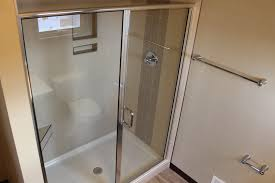 5335 master shower with glass door design with fiberglass pan and tile walls