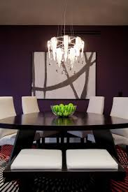 triangle dining table area rugs blown glass chandelier contemporary art dining chairs contemporary rug dark paint
