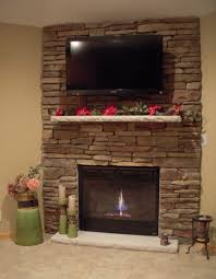 attractive stacked stone fireplace design featuring stacked stone surround and white stone fireplace mantel