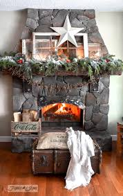 fireplace mantel with old windows and garland