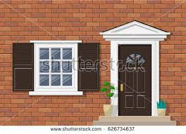 brick house exterior with porch front door window and potted plants