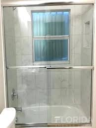 frameless bypass glass shower doors 1 4 semi sliding bypass tub enclosure with pound on towel bars frameless sliding glass shower doors