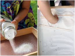 the children spent several minutes exploring the soft fine sand running their hands through it and sifting the tiny grains with their fingers