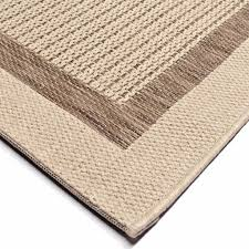 outdoor indoor flat weave woven rug shades of tan ivory