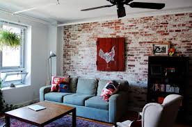 exposed brick wall as decorative brick wall in industrial living room with decorative pillows for couches