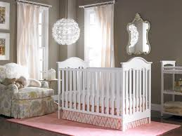 baby girl room chandelier. Design Ideas, Baby Girl Nursery Pink And White Crib Crystal Chandelier Wooden Laminate Flooring Upholstered Room U