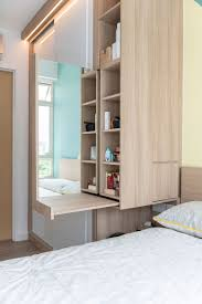 this dressing table pulls out from the built in wardrobe functioning as a super space saver the vanity is located just next to the bed which serves as a