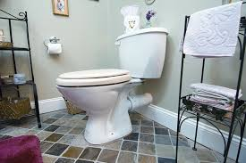 an upflushing toilet is not inexpensive but it offers a convenient and relatively trouble free way of making a basement level bathroom work