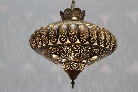 pierced brass moroccan pendants in the style of alberto pinto moorish design this moroccan light