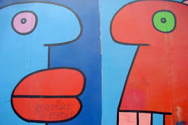 go to previous picture picture of colourful art on berlin wall east side gallery  on famous berlin wall graffiti artist with detail of a colourful piece of art thierry noir france east