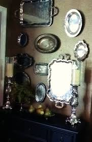 Decorating With Silver Trays old silver plate yard sale or Good Will trays hung on a wall 51